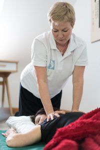 A picture of the practitioner giving the client shiatsu