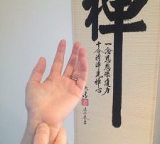 A picture of a hand and acupressure point Heart 7 being pressed
