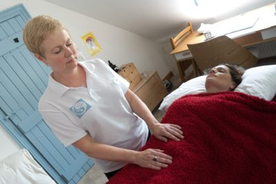 Practitioner giving Reiki to a client